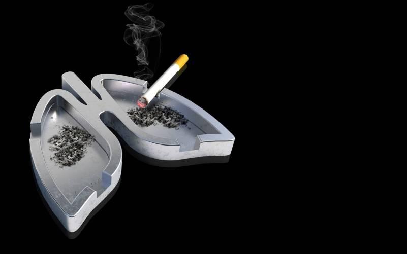 Tüdő alakú hamutál cigarettával (illusztráció)